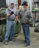 Two of our fine employees manufacturing our new line Golden Spike rebar stands